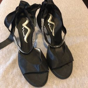 Black heels with rhinestone ribbons around ankle